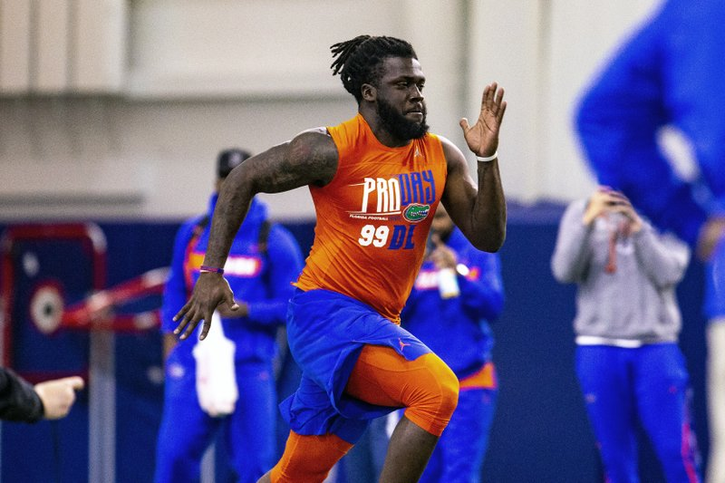Defensive lineman Jachai Polite runs the 40-yard dash during University of Florida's football Pro Day in Gainesville, Fla. (Lauren Bacho/The Gainesville Sun via AP)