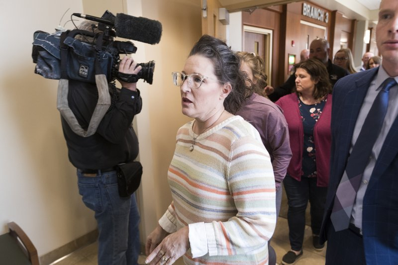 Lynn Closs, aunt of Jayme Closs, leaves the courtroom after Jake Patterson plead guilty Wednesday, March 27, 2019 at the Barron County Justice Center in Barron, Wis. (Mark Hoffman/Milwaukee Journal-Sentinel via AP)