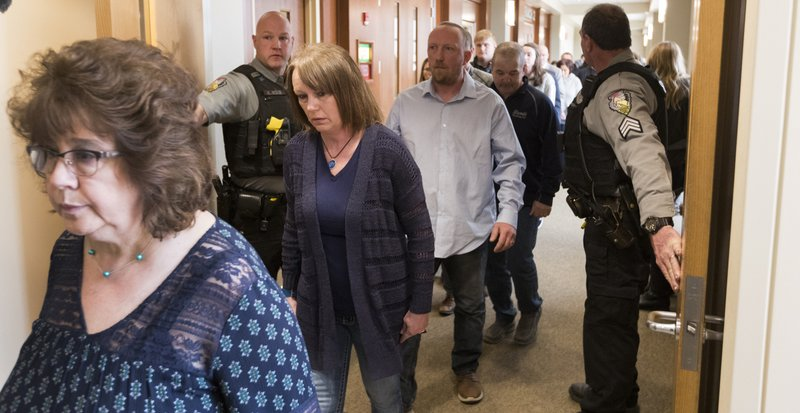 Sue Allard, center, Jayme Closs' aunt, leaves the courtroom after Jake Patterson pleaded guilty to kidnapping 13-year-old Jayme Closs, killing her parents and holding her captive in a remote cabin for three months, Wednesday, March 27, 2019 at the Barron County Justice Center in Barron, Wis. (Mark Hoffman/Milwaukee Journal-Sentinel via AP)