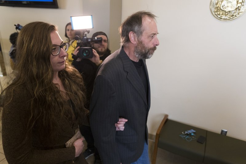 Patrick Patterson, right, and his daughter, Katie, arrive for the arraignment hearing of his son, Jake Patterson, Wednesday, March 27, 2019 at the Barron County Justice Center in Barron, Wis. (Mark Hoffman/Milwaukee Journal-Sentinel via AP)