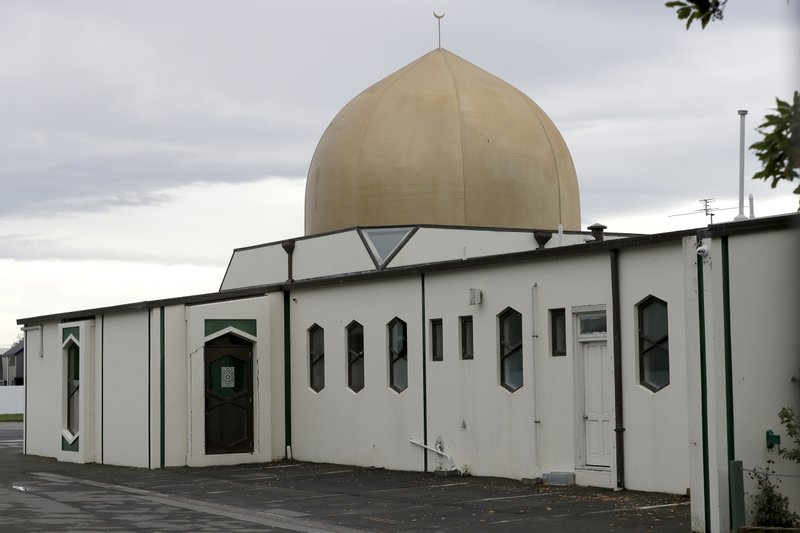 In this March 27, 2019, photo, the outside of thee Al Noor mosque which shows the door that volunteer Khaled Alnobani escaped through when a gunman burst into the mosque on March 15 in Christchurch, New Zealand. (AP Photo/Mark Baker)