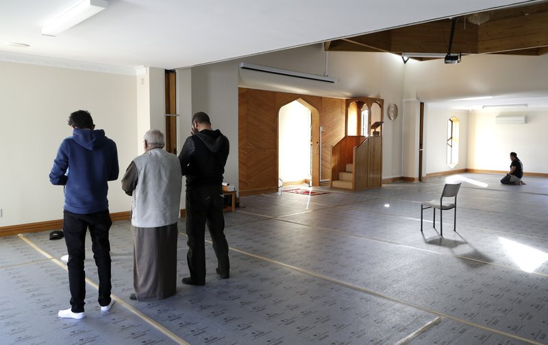 In this March 27, 2019, photo, Muslim men pray in the refurbished Al Noor mosque following the March 15 shootings in Christchurch, New Zealand. (AP Photo/Mark Baker)
