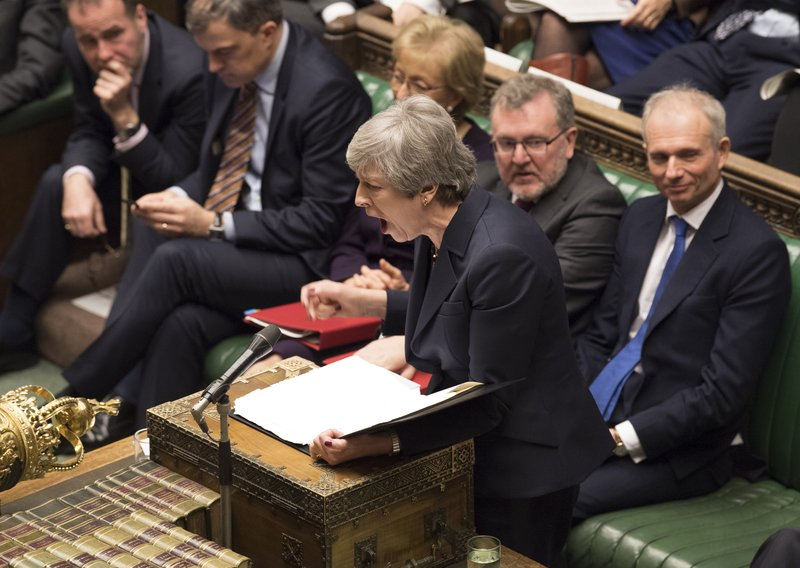 Britain's Prime Minister Theresa May stands to face opposition lawmakers inside the House of Commons parliament in London Wednesday March 27, 2019. (Mark Duffy/House of Commons via AP)