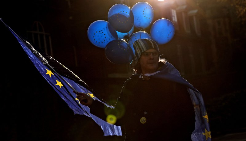 A Pro EU protestor demonstrates in front of the Houses of Parliament in London, Wednesday, March 27, 2019. (AP Photo/Frank Augstein)