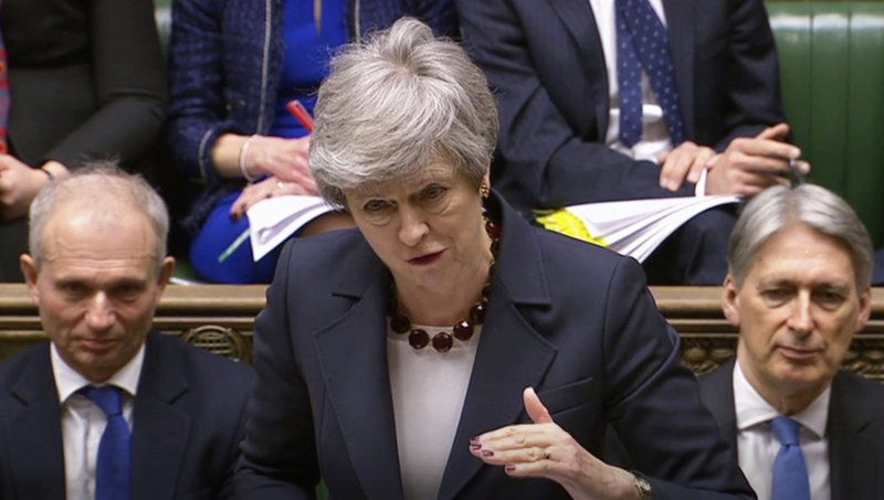In this grab taken from video, Britain's Prime Minister Theresa May speaks during Prime Minister's Questions in the House of Commons, London, Wednesday March 27, 2019. (House of Commons/PA via AP)