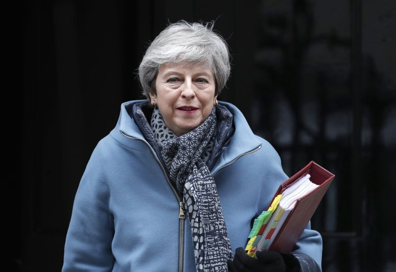 Britain's Prime Minister Theresa May leaves 10 Downing street to attend her weekly Prime Minster's Questions at the House of Commons, in London, Wednesday, March 27, 2019. (AP Photo/Alastair Grant)