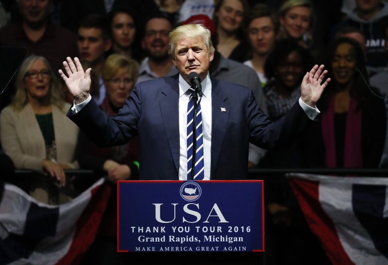 FILE - In this Dec. 9, 2016, file photo, President-elect Donald Trump speaks to supporters during a rally, in Grand Rapids, Mich. (AP Photo/Paul Sancya, File)
