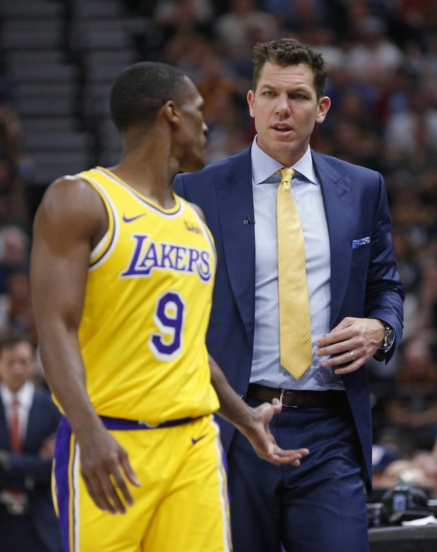 Los Angeles Lakers coach Luke Walton speaks with guard Rajon Rondo during the first half of the team's NBA basketball game against the Utah Jazz on Wednesday, March 27, 2019, in Salt Lake City. (AP Photo/Rick Bowmer)