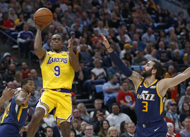 Los Angeles Lakers guard Rajon Rondo (9) shoots as Utah Jazz guard Ricky Rubio (3) defends during the first half of an NBA basketball game Wednesday, March 27, 2019, in Salt Lake City. (AP Photo/Rick Bowmer)