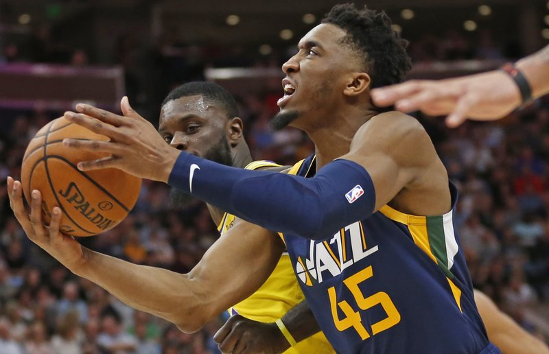 Utah Jazz guard Donovan Mitchell (45) lays the ball up as Los Angeles Lakers guard Lance Stephenson defends during the second half of an NBA basketball game Wednesday, March 27, 2019, in Salt Lake City. (AP Photo/Rick Bowmer)