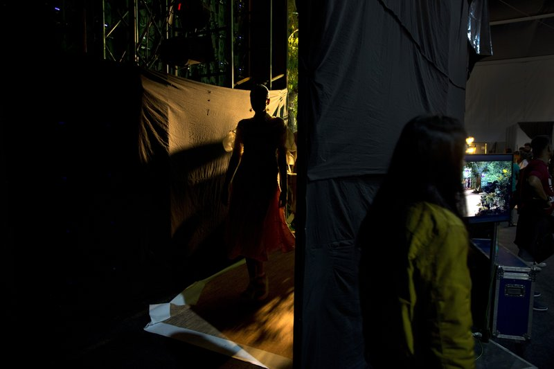 In this Wednesday, March 13, 2019, photo, a model returns to the backstage after leaving the ramp during the Lotus Makeup India Fashion Week, in New Delhi, India. (AP Photo/Manish Swarup)