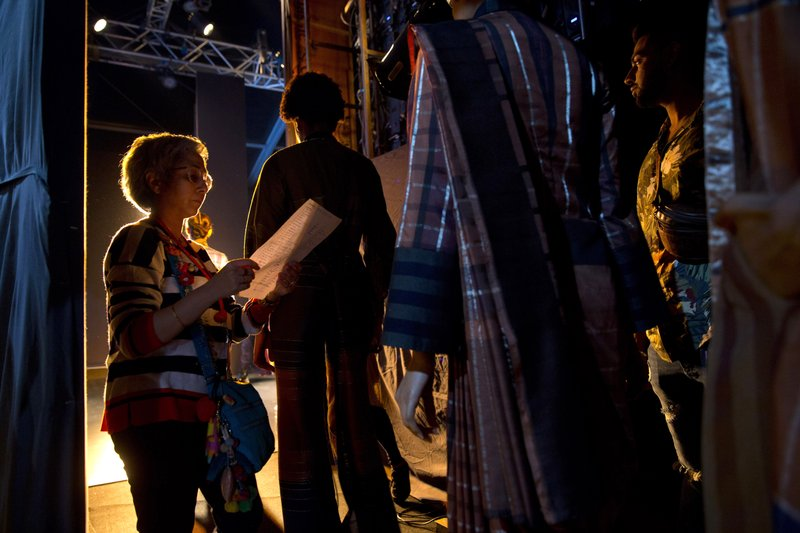 In this Wednesday, March 13, 2019, photo, a backstage manager checks the line up moments before a show during Lotus Makeup India Fashion Week, in New Delhi, India. (AP Photo/Manish Swarup)