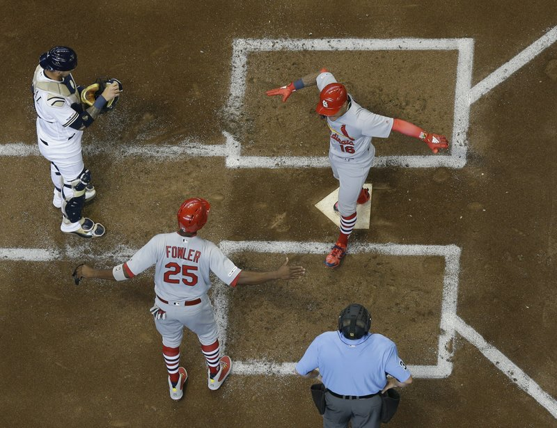 St. Louis Cardinals' Kolten Wong celebrates with Dexter Fowler after hitting a two-run home run during the second inning of an Opening Day baseball game against the Milwaukee Brewers Thursday, March 28, 2019, in Milwaukee. (AP Photo/Morry Gash)