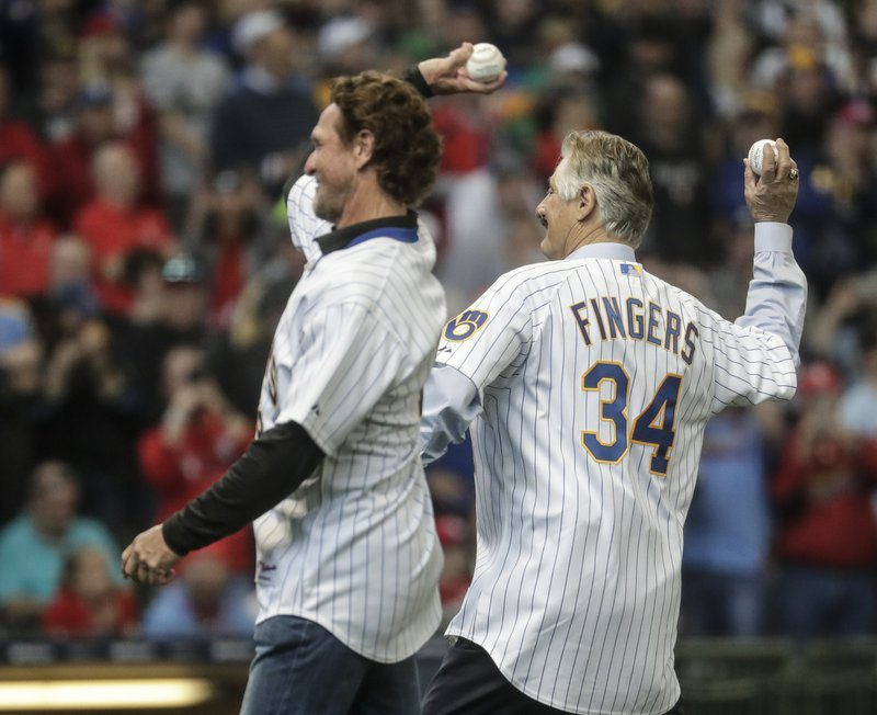 Former Milwaukee Brewers' Rollie Fingers and Robin Count throw out ceremonial first pitches before an Opening Day baseball game against the St. (AP Photo/Morry Gash)