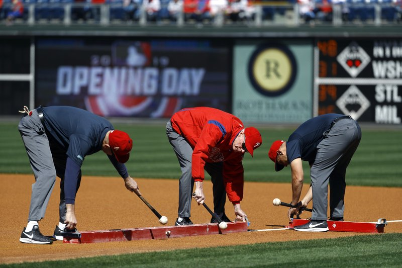 Grounds crew put the lines down on the field at Citizens Bank Park as fans arrive for an opening day baseball game between the Atlanta Braves and the Philadelphia Phillies, Thursday March 28, 2019, in Philadelphia. (AP Photo/Matt Slocum)