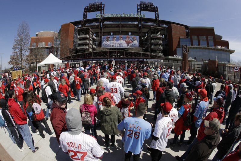 Fans gather for the Philadelphia Phillies opening day baseball game against the Atlanta Braves at Citizens Bank Park in Philadelphia, Thursday March 28, 2019. (AP Photo/Matt Rourke)