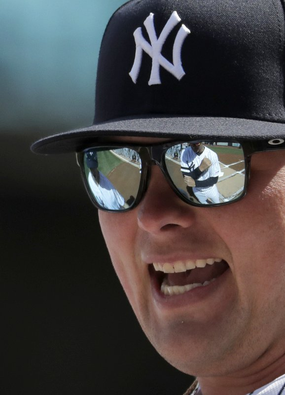 New York Yankees manager Aaron Boone is reflected in the sunglasses of Luke Voit prior to an opening day baseball game against the Baltimore Orioles at Yankee Stadium, Thursday, March 28, 2019, in New York. (AP Photo/Julio Cortez)
