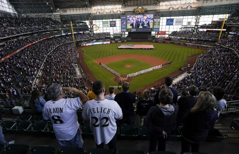 Fans stand for the national anthem at Miller Park before an Opening Day baseball game between the Milwaukee Brewers and the St. (AP Photo/Morry Gash)