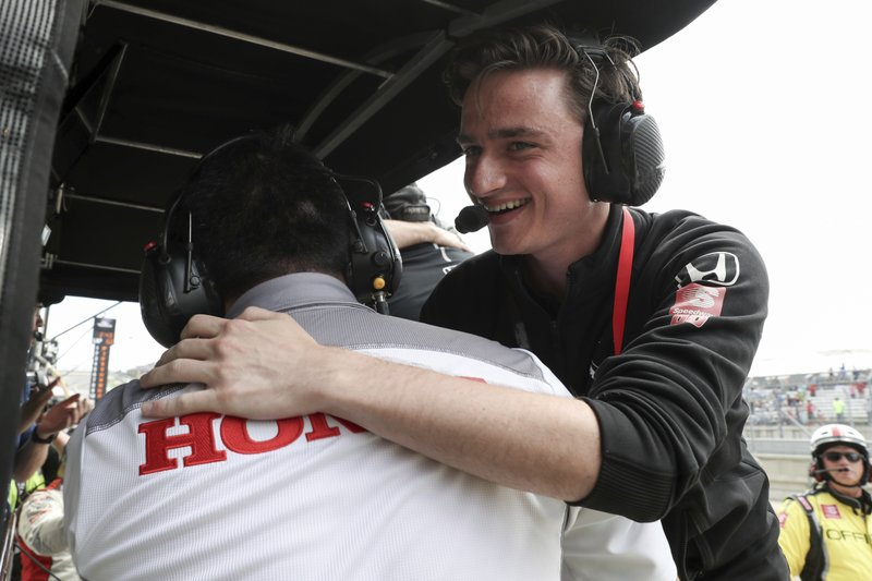 This photo provided by IndyCar shows team owner George Steinbrenner IV hugging a Honda Performance Development employee after driver Colton Herta won the IndyCar Classic auto race in Austin, Texas on Sunday, March 24, 2019. (Joe Skibinski/IndyCar via AP)
