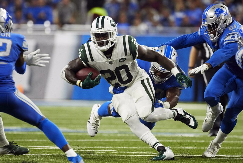 FILE - In this Sept. 10, 2018, file photo, New York Jets running back Isaiah Crowell (20) rushes against the Detroit Lions during an NFL football game at Ford Field in Detroit. (AP Photo/Rick Osentoski, File)
