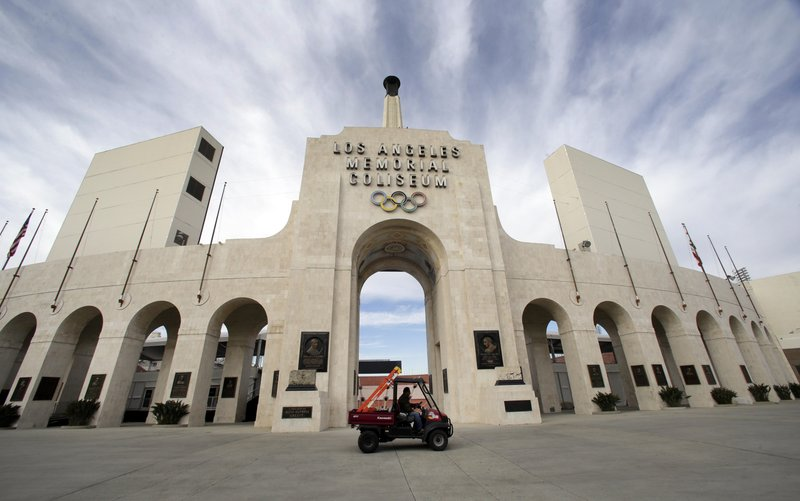 FILE - This Jan. 13, 2016 file photo shows the peristyle of the Los Angeles Memorial Coliseum in Los Angeles. (AP Photo/Nick Ut, File)