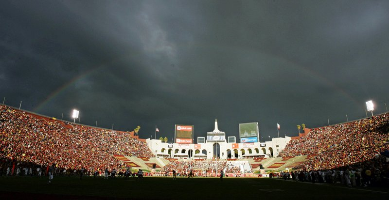 FILE - In this Sept. 22, 2007 file photo, a rainbow forms over the Los Angeles Memorial Coliseum during the Southern California and Washington State NCAA college football game in Los Angeles. (AP Photo/Chris Carlson, File)