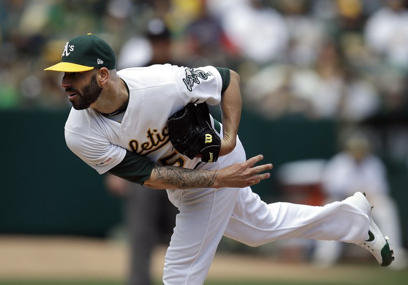 Oakland Athletics pitcher Mike Fiers works against the Los Angeles Angels in the first inning of a baseball game Thursday, March 28, 2019, in Oakland, Calif. (AP Photo/Ben Margot)