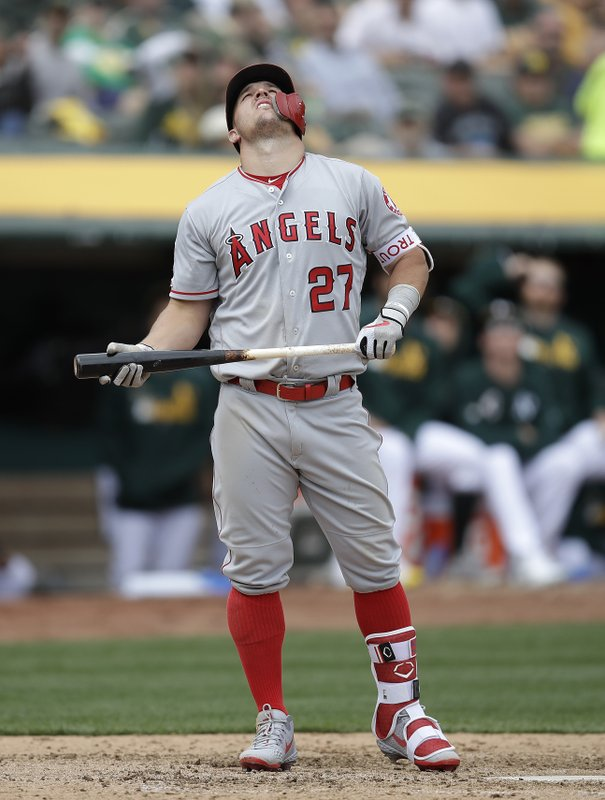 Los Angeles Angels' Mike Trout eyes a pop up he hit off Oakland Athletics' Mike Fiers in the sixth inning of a baseball game Thursday, March 28, 2019, in Oakland, Calif. (AP Photo/Ben Margot)