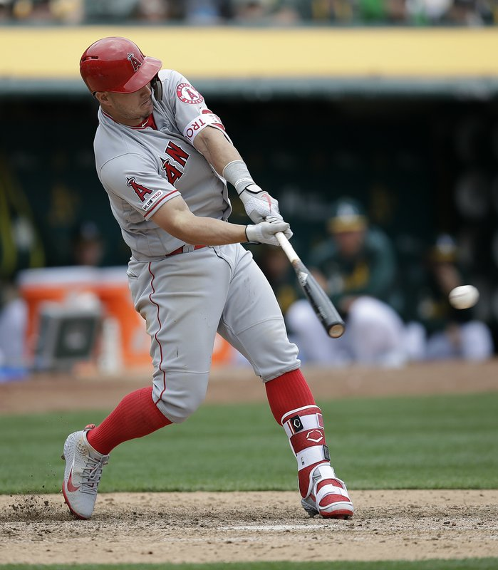 Los Angeles Angels' Mike Trout swings for a double off Oakland Athletics' Joakim Soria in the eighth inning of a baseball game Thursday, March 28, 2019, in Oakland, Calif. (AP Photo/Ben Margot)