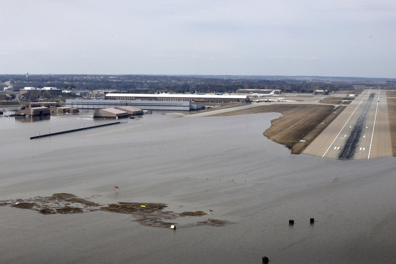 FILE - This March 17, 2019 file photo provided by the U.S. Air Force shows an aerial view of Offutt Air Force Base and surrounding areas in Nebraska affected by flood waters. (Tech. Sgt. Rachelle Blake/U.S. Air Force via AP, File)