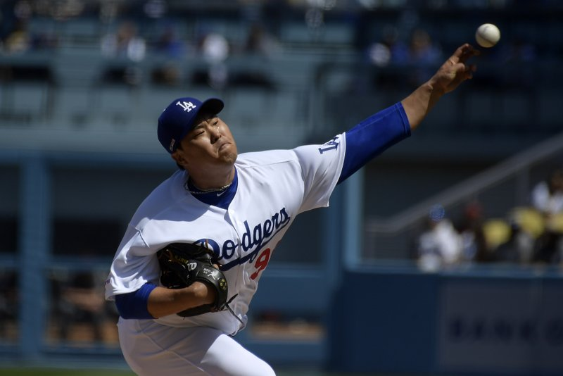 Los Angeles Dodgers starting pitcher Hyun-Jin Ryu throws to the plate during the first inning of a baseball game against the Arizona Diamondbacks Thursday, March 28, 2019, in Los Angeles. (AP Photo/Mark J. Terrill)