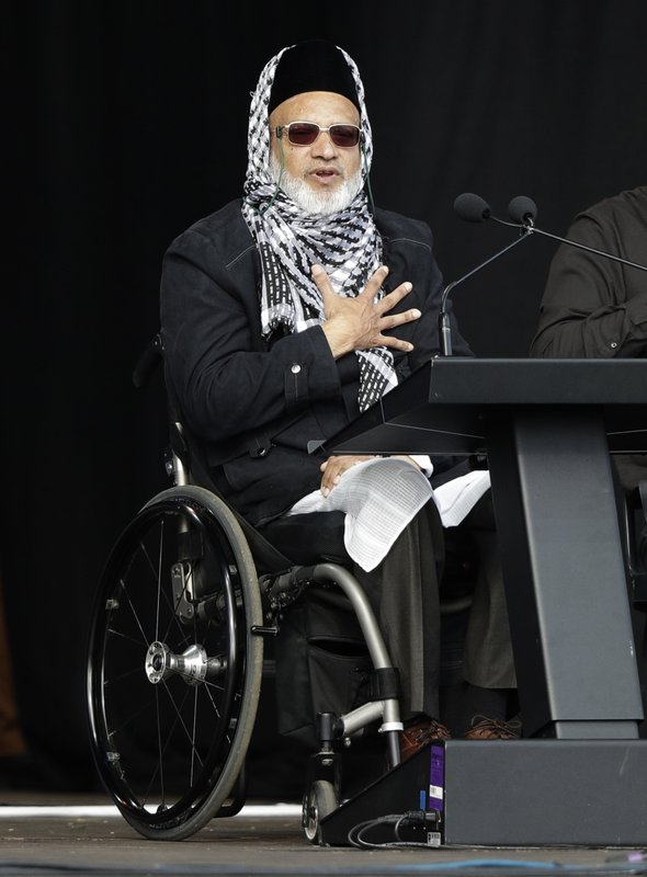 Mosque shooting survivor Farid Ahmed addresses the national remembrance service in Hagley Park for the victims of the March 15 mosques terrorist attack in Christchurch, New Zealand, Friday, March 29, 2019. (AP Photo/Mark Baker)