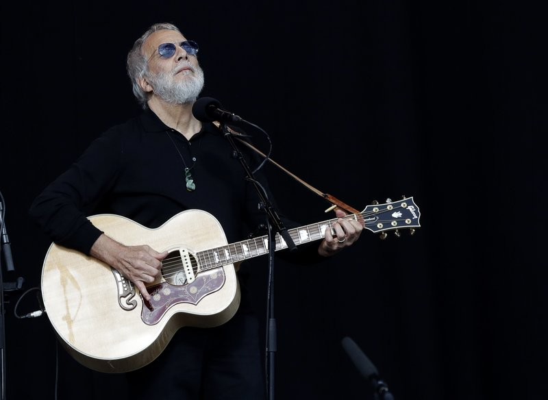 Yusuf Islam/Cat Stevens sings during a national remembrance service in Hagley Park for the victims of the March 15 mosque terrorist attack in Christchurch, New Zealand, Friday, March 29, 2019. (AP Photo/Mark Baker)