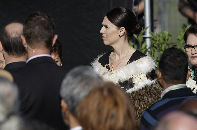 New Zealand Prime Minister Jacinda Ardern , right, arrives for a National Remembrance Service in Hagley Park for the victims of the March 15 mosques terrorist attack in Christchurch, New Zealand, Friday, March 29, 2019. (AP Photo/Mark Baker)