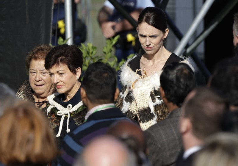 New Zealand Prime Minister Jacinda Ardern, right, arrives for a National Remembrance Service in Hagley Park for the victims of the March 15 mosques terrorist attack in Christchurch, New Zealand, Friday, March 29, 2019. (AP Photo/Mark Baker)