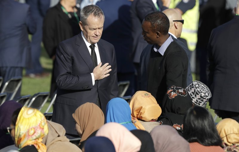 Australian Labor Party leader Bill Shorten greets guests at the national remembrance service in Hagley Park for the victims of the March 15 mosques terrorist attack in Christchurch, New Zealand, Friday, March 29, 2019. (AP Photo/Mark Baker)