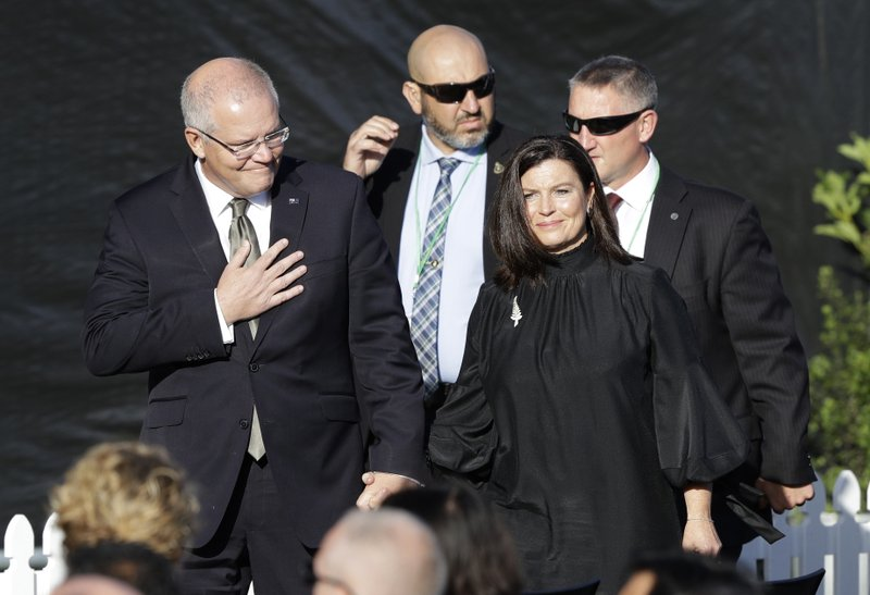Australian Prime Minister Scott Morrison, left, and his wife Jenny arrive at the national remembrance service in Hagley Park for the victims of the March 15 mosques terrorist attack in Christchurch, New Zealand, Friday, March 29, 2019. (AP Photo/Mark Baker)