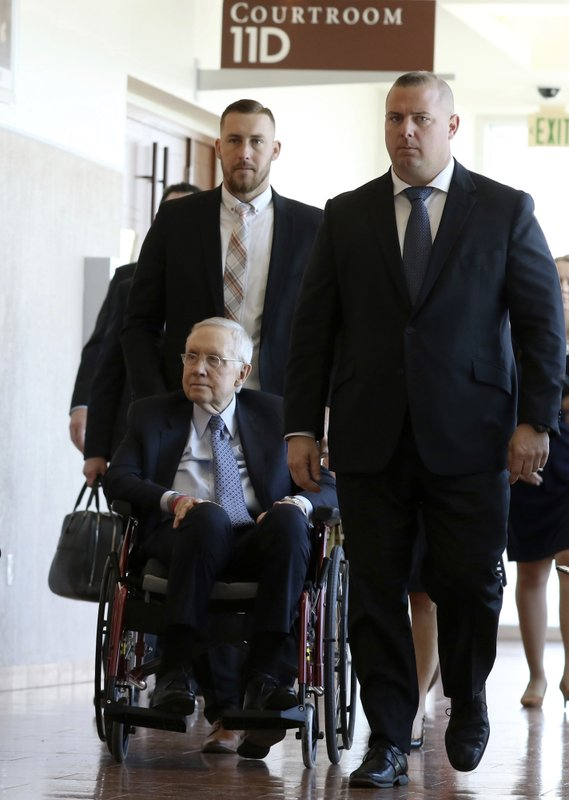 Former U.S. Senator Harry Reid, who sued the makers of an exercise band after injuring his eye, leaves the courtroom after attending the first day of jury selection in his civil trial at the Regional Justice Center on Monday, March. (Bizuayehu Tesfaye/Las Vegas Review-Journal via AP)