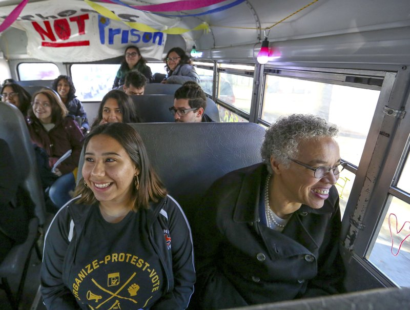 In this March 24, 2019 photo, Chicago mayoral candidate Toni Preckwinkle takes a bus tour of the Brighton Park neighborhood of Chicago, with members of the Brighton Park neighborhood during a day of campaigning in Chicago. (AP Photo/Teresa Crawford)