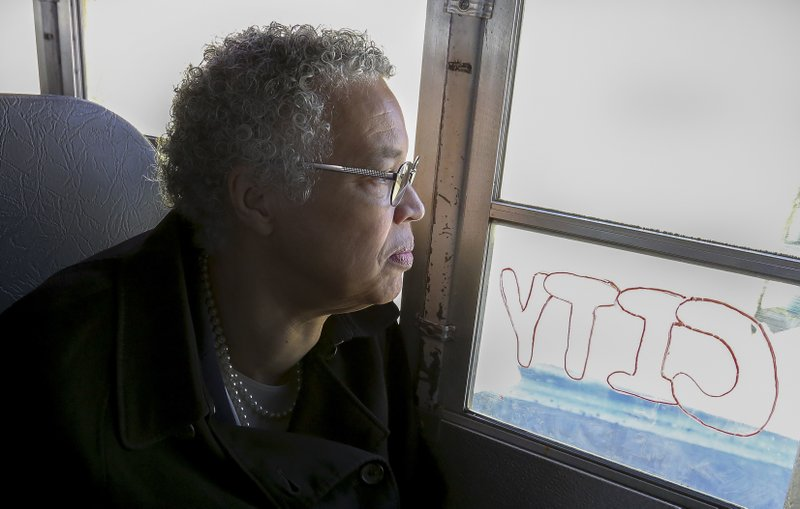 In this March 24, 2019 photo, Chicago mayoral candidate Toni Preckwinkle looks out over the Brighton Park neighborhood of Chicago, on a bus tour with members of the Brighton Park Neighborhood Council during a day of campaigning in Chicago. (AP Photo/Teresa Crawford)