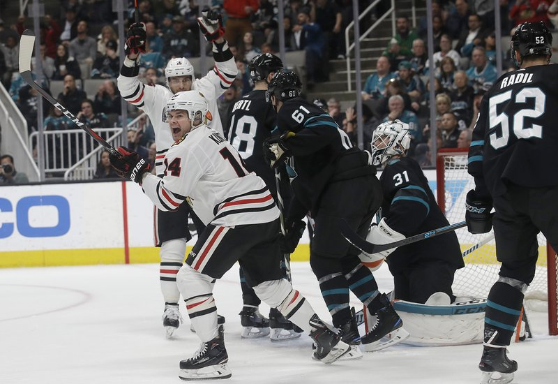 Chicago Blackhawks left wing Chris Kunitz, foreground left, celebrates after scoring a goal against the San Jose Sharks during the second period of an NHL hockey game in San Jose, Calif. (AP Photo/Jeff Chiu)