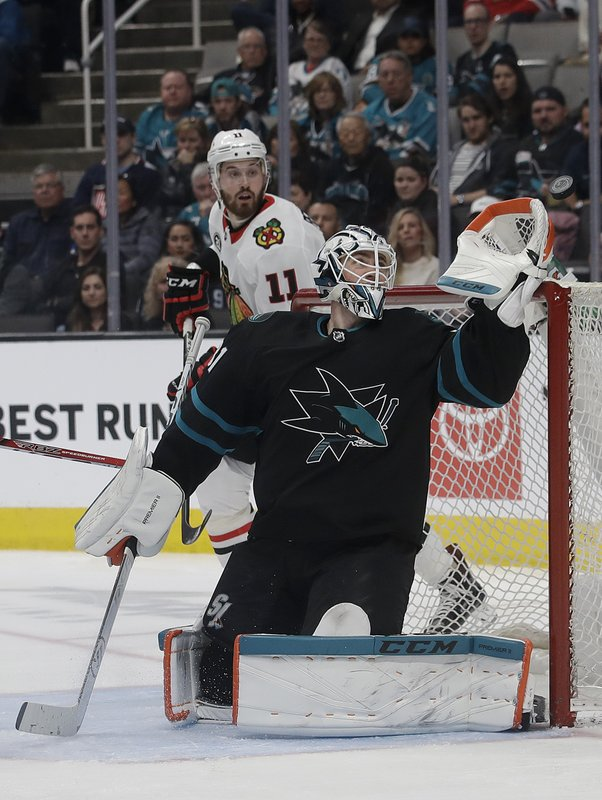 San Jose Sharks goaltender Martin Jones reaches for the puck during the second period of the team's NHL hockey game against the Chicago Blackhawks in San Jose, Calif. (AP Photo/Jeff Chiu)