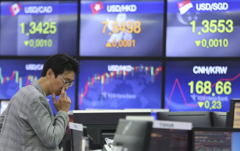A currency trader watches monitors at the foreign exchange dealing room of the KEB Hana Bank headquarters in Seoul, South Korea, Friday, March 29, 2019. (AP Photo/Ahn Young-joon)