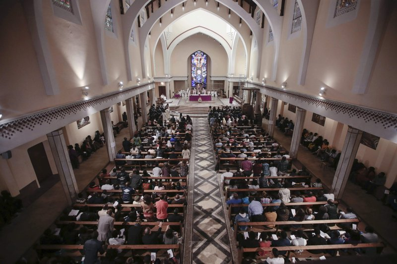 FILE - In this Sunday, March 10, 2019 file photo, Christians, mostly sub-Saharan migrants, take part in a Sunday mass in a cathedral in Rabat, Morocco. (AP Photo/Mosa'ab Elshamy, File)