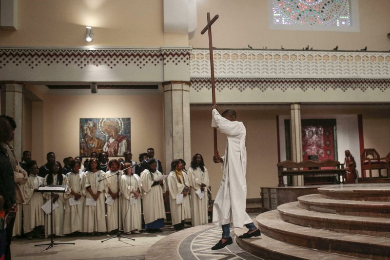 FILE - In this Sunday, March 10, 2019 file photo, Christians, mostly sub-Saharan migrants, attend mass in a cathedral in Rabat, Morocco. (AP Photo/Mosa'ab Elshamy, File)