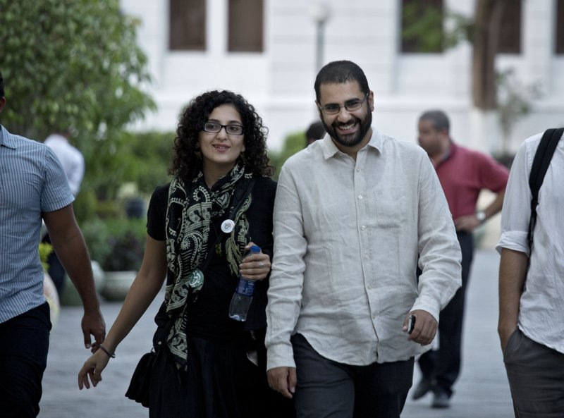 FILE - In this Sept. 22, 2014 file photo, Egypt's leading pro-democracy activist Alaa Abdel-Fattah walks with his sister Mona Seif prior to a conference held at the American University in Cairo, near Tahrir Square, Egypt. (AP Photo/Nariman El-Mofty, File)