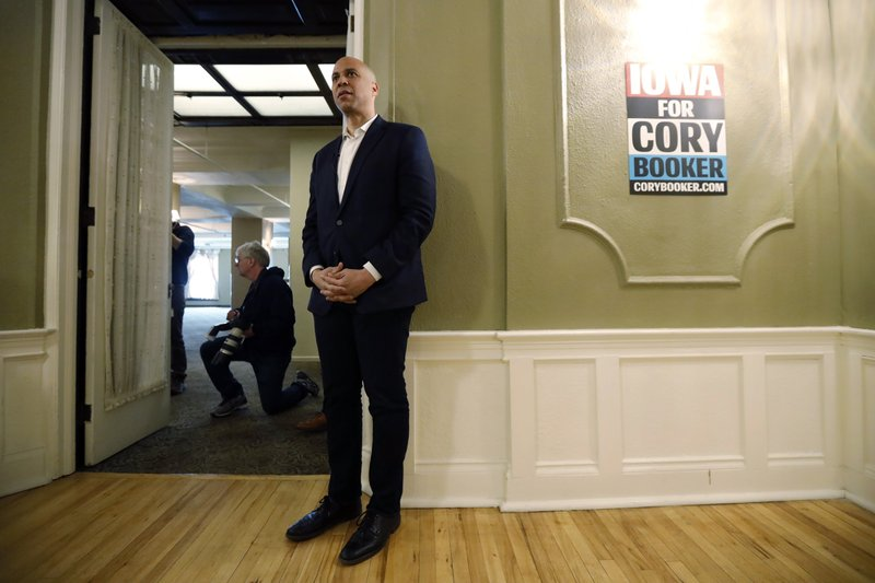 2020 Democratic presidential candidate Sen. Cory Booker waits to speak at a meeting with local residents, Saturday, March 16, 2019, in Ottumwa, Iowa. (AP Photo/Charlie Neibergall)