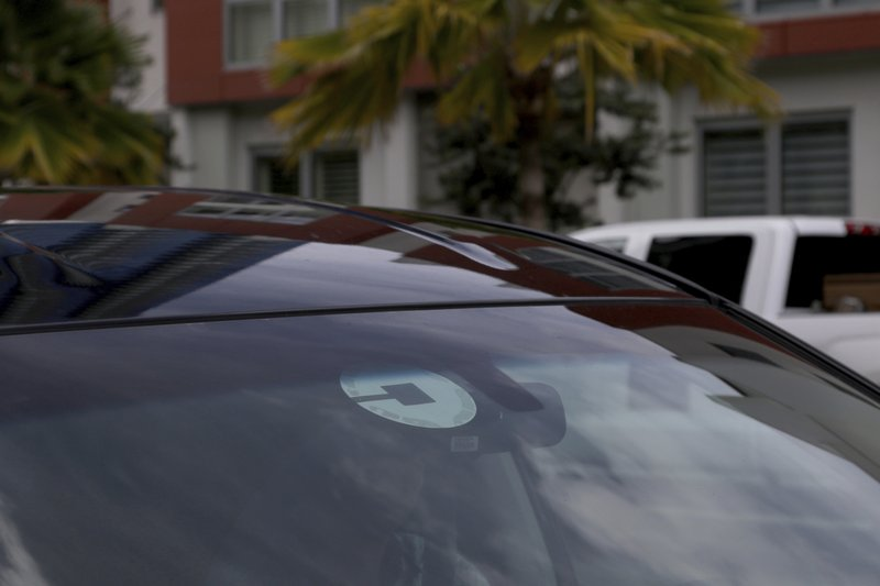 FILE- In this June 6, 2018, file photo Uber driver Joshua Oh drives in Honolulu. The 4G speeds, what we're used to today, made possible many of the things we now take for granted on our phones, Instagram, cloud storage, Netflix. (AP Photo/Caleb Jones, File)