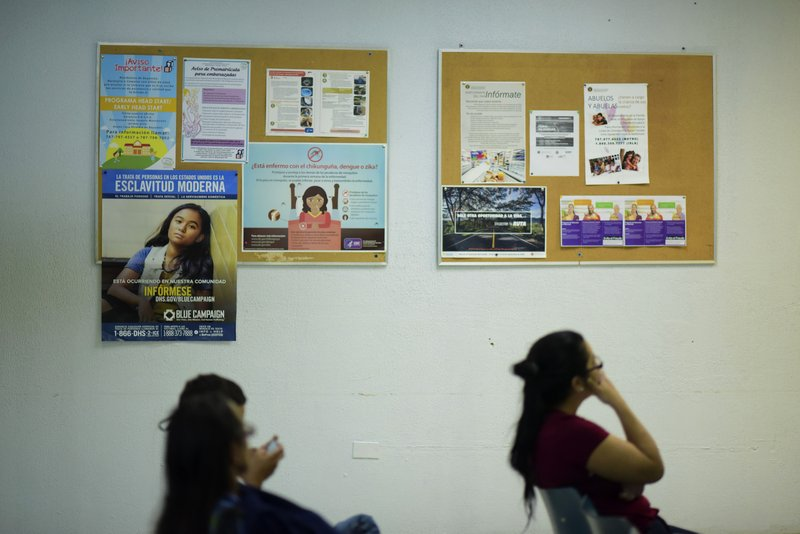 Puerto Rican citizens wait their turn at the Department of Family Affairs, in Bayamon, Puerto Rico, Friday, March 29, 2019. (AP Photo/Carlos Giusti)