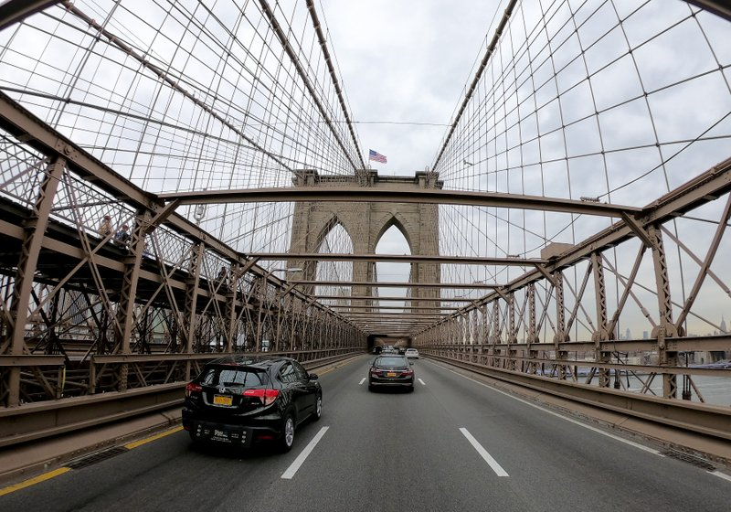 Motorists cross over the Brooklyn Bridge heading west into Manhattan, Friday, March 29, 2019, in New York. (AP Photo/Julie Jacobson)